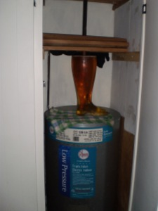 The beer boot, warming up in the hot water cupboard and waiting for the foam to settle