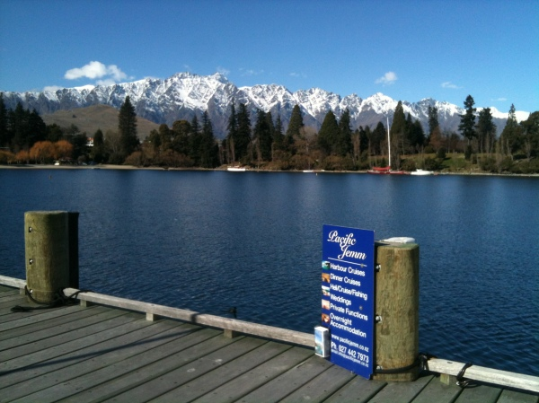 Queenstown - Dock at Lake Wakatipu with view of mountains